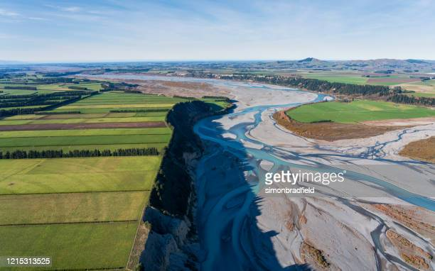elevated view of the waimakariri river, new zealand - christchurch stock pictures, royalty-free photos & images