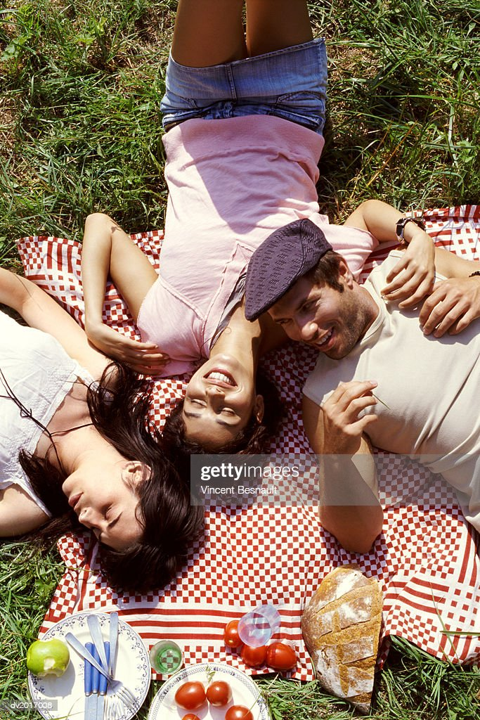 Elevated View of Three Friends Relaxing at a Picnic : Stock Photo