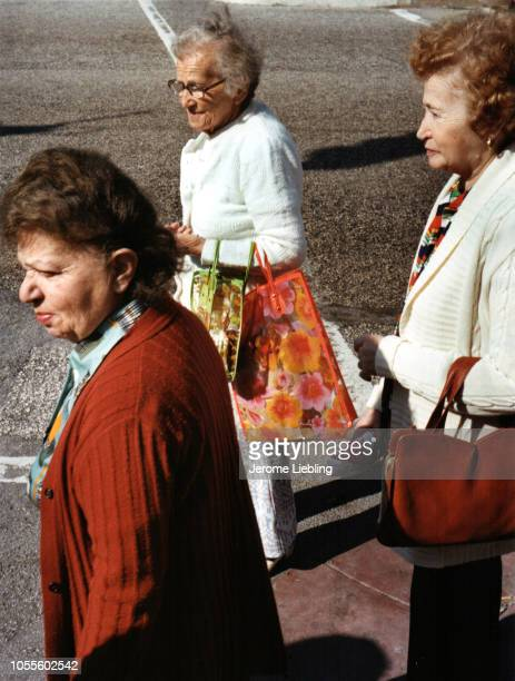 Elevated view of three unidentified elderly women at an intersection Miami Beach Florida 1985