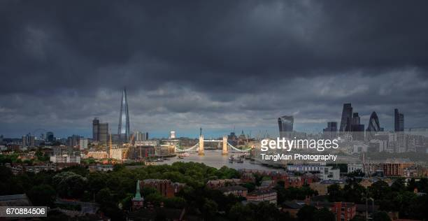 Elevated View of Tower Bridge and London The City Along The Thames in a Cloudy Day