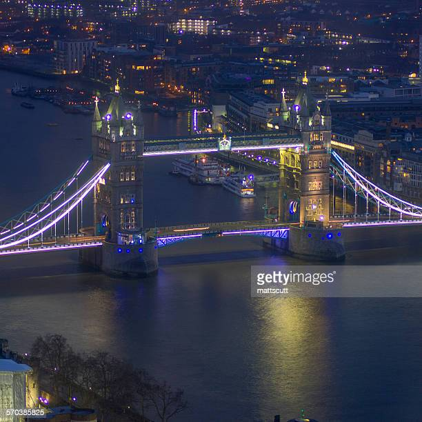 Elevated view of Tower Bridge at night, London, UK