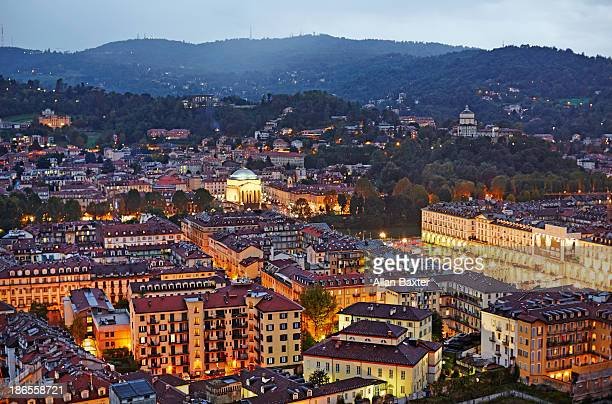 Elevated view of Turin illuminated at dusk
