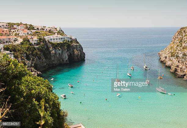 elevated view of two boats and yachts anchored in bay, menorca, balearic islands, spain - ミノルカ ストックフォトと画像
