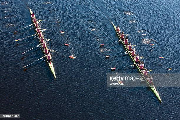 elevated view of two rowing eights in water - contest stock pictures, royalty-free photos & images