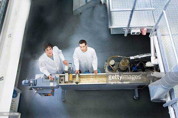elevated view of two technicians in working laboratory - sigrid gombert stock-fotos und bilder