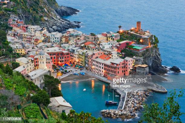 elevated view of vernazza at dusk - liguria stock photos and pictures