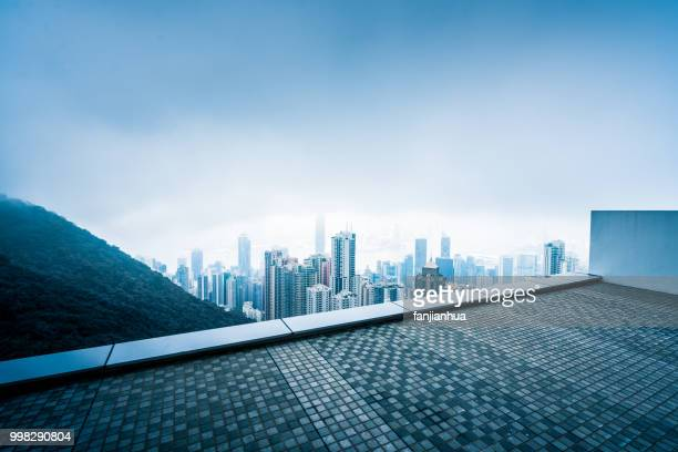 elevated view of victoria harbor in fog - roof stock pictures, royalty-free photos & images