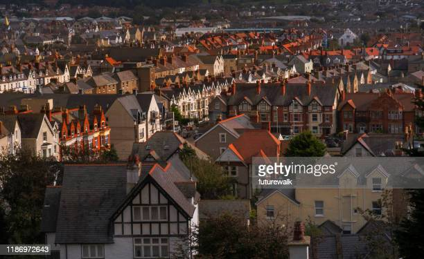 elevated view of victorian buildings in a downtown district of llandudno, wales - wales stock pictures, royalty-free photos & images