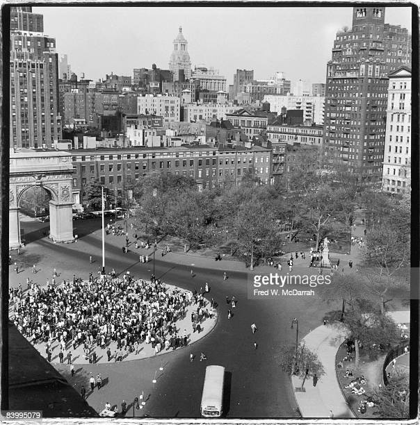 Elevated view of Washington Square Park where a large gathering of people are seen at lower left May 1959