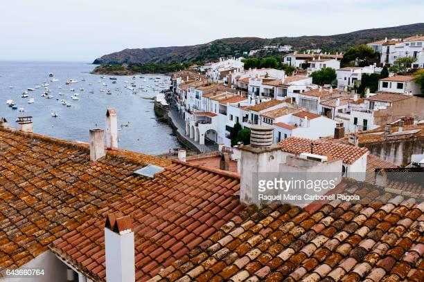 AMPURDAN GERONA CATALONIA SPAIN Elevated view of white town by sea