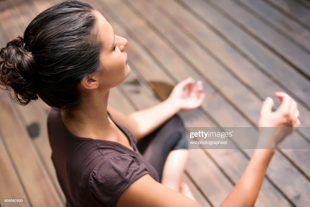 Elevated view of woman meditating : Stock Photo