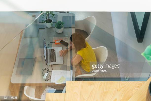 elevated view of woman working from home - makeshift stock pictures, royalty-free photos & images