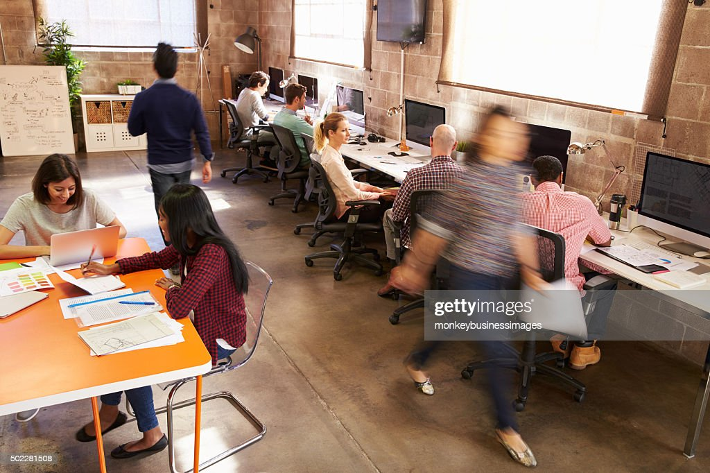 wide angle view busy design office. Elevated View Of Workers In Busy Modern Design Office Wide Angle F