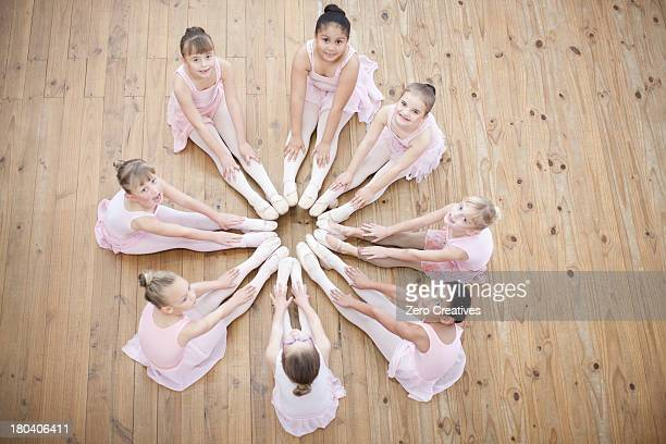 Elevated view of young ballerina in circle formation