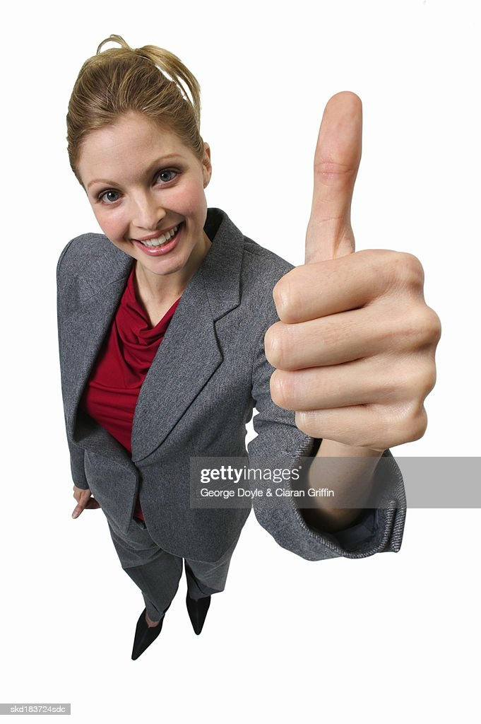 Elevated view of young businesswoman giving thumbs up : Stock Photo