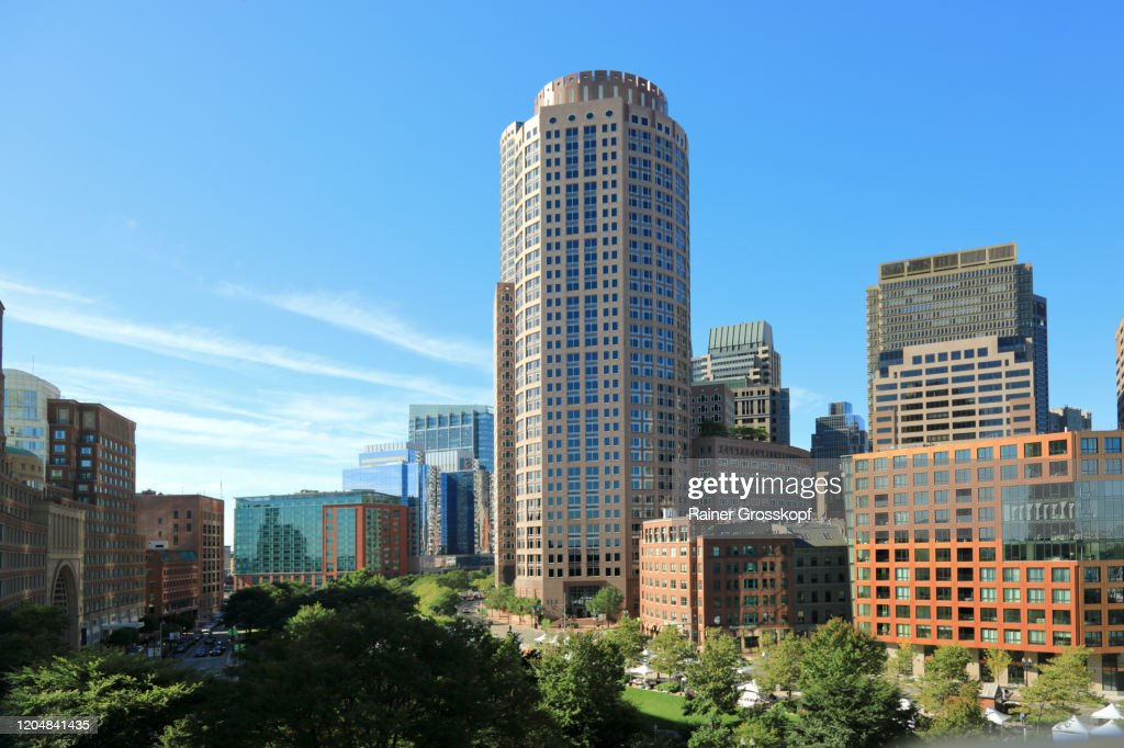 Elevated view over a park area at skyscrapers against blue sky : Stock Photo