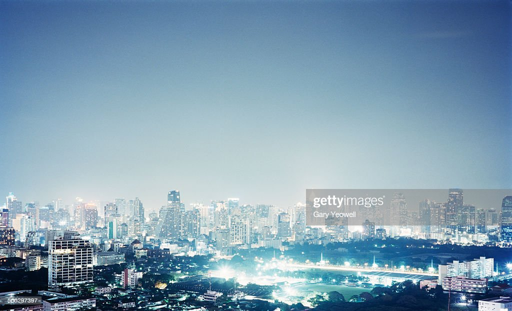 Elevated view over city illuminated at night : Stock Photo