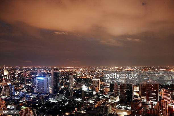 elevated view over city of bangkok at night - yeowell stock pictures, royalty-free photos & images