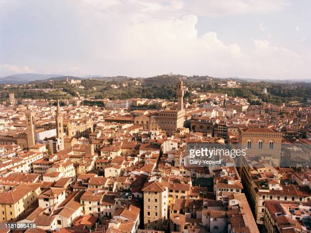 elevated view over florence skyline rooftops - florence italy stock pictures, royalty-free photos & images