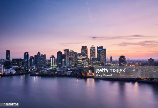 elevated view over london canary wharf skyline - canary wharf stock pictures, royalty-free photos & images