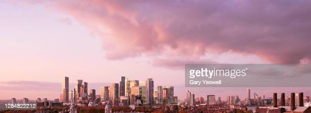 elevated view over london city canary wharf skyline at sunset - skyline stock pictures, royalty-free photos & images