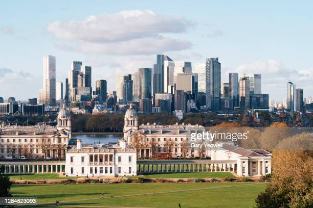 elevated view over london city canary wharf skyline at sunset - london stock pictures, royalty-free photos & images