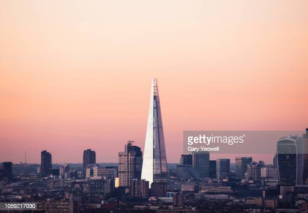 elevated view over london city skyline at dusk - shard london bridge stock pictures, royalty-free photos & images