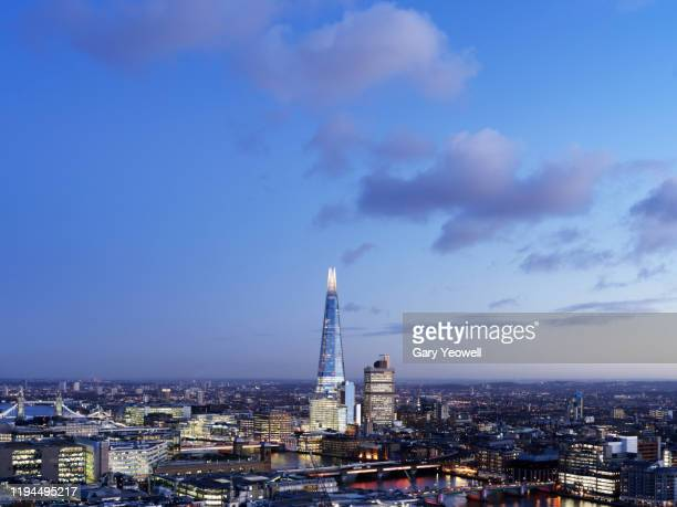 elevated view over london city skyline at dusk - horizon stock pictures, royalty-free photos & images