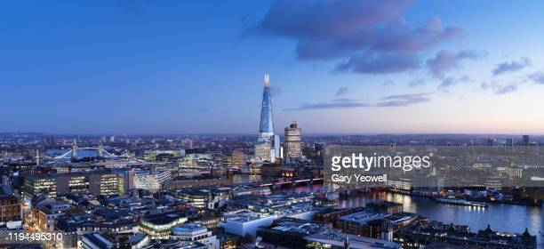 elevated view over london city skyline at dusk - central london stock pictures, royalty-free photos & images