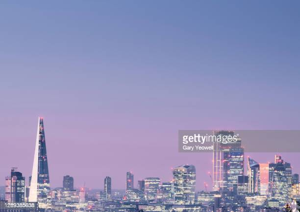 elevated view over london city skyline at dusk - business finance and industry stock pictures, royalty-free photos & images