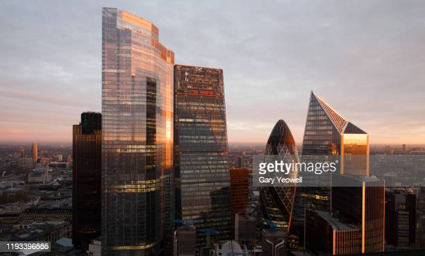 elevated view over london city skyline at sunrise - morning stock pictures, royalty-free photos & images