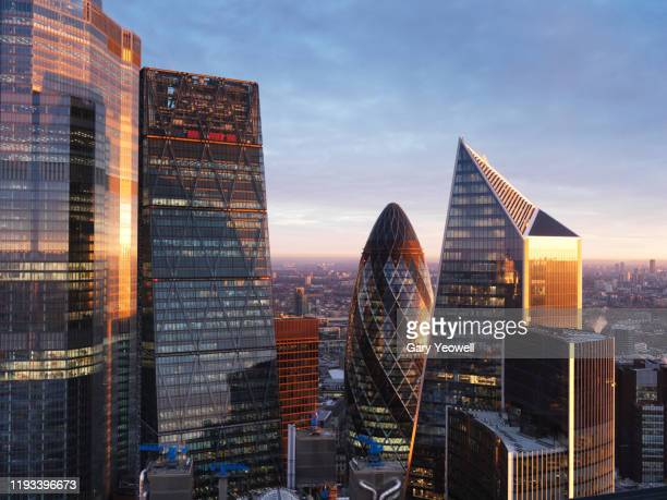 elevated view over london city skyline at sunrise - city stock pictures, royalty-free photos & images
