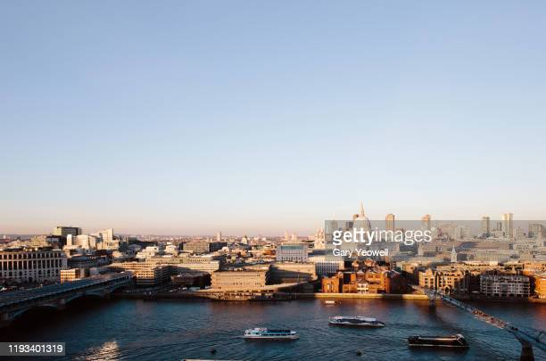 elevated view over london city skyline at sunset - river stock pictures, royalty-free photos & images