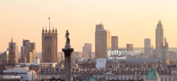 elevated view over london city skyline at sunset - city of westminster london stock pictures, royalty-free photos & images