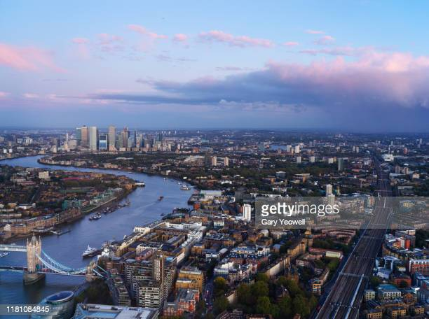 elevated view over london city skyline at twilight - central london stock-fotos und bilder