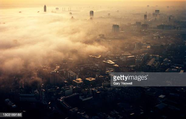 elevated view over london city skyline in fog - horizon over land stock pictures, royalty-free photos & images