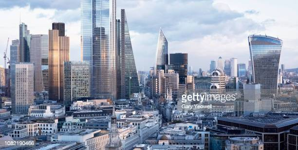 elevated view over london financial district at sunset - financial district stock pictures, royalty-free photos & images
