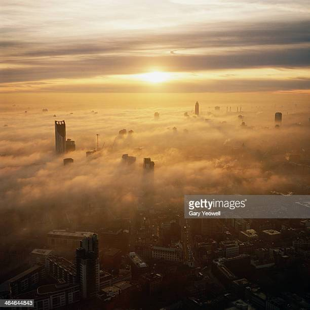 Elevated view over London shrouded in mist