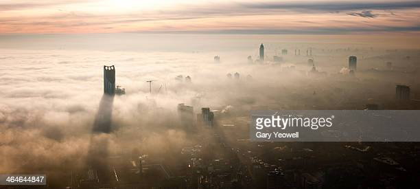 elevated view over london shrouded in mist - fog stock pictures, royalty-free photos & images