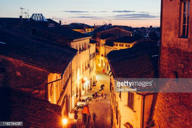 elevated view over rooftops at dusk in san miniato - san miniato stock pictures, royalty-free photos & images