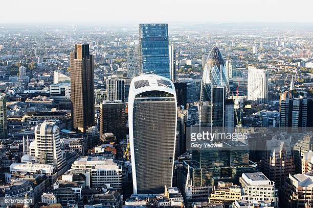 elevated view over the city of london at sunset - london financial district stock photos and pictures