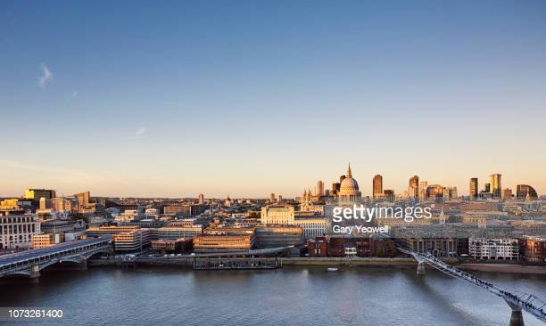 elevated view over the city of london skyline at sunset - st. paul's cathedral london stock pictures, royalty-free photos & images