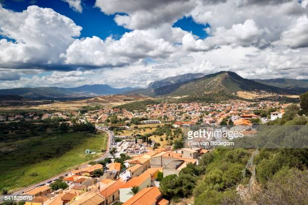 Elevated view over the historic town centre of Posada, Sardinia, and its surrounding landscape