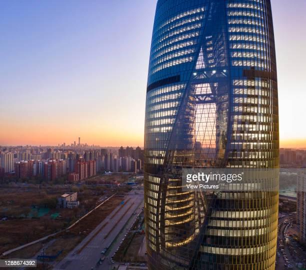 Elevated view through glass curtain facade. Leeza SOHO, Beijing, China. Architect: Zaha Hadid Architects, 2019.