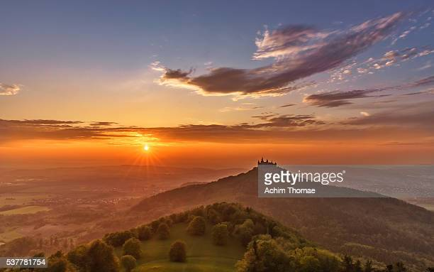 Elevated view towards Hohenzollern Castle & surrounding countryside at sunset, Swabia, Baden Wuerttemberg, Germany
