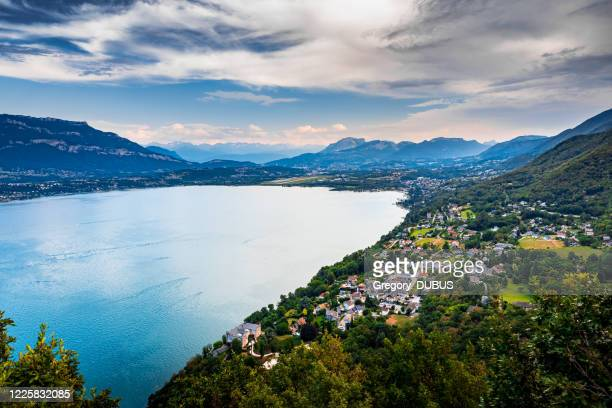 elevated viewpoint over small french village of bourdeau on the edge of lake bourget near aix les bains and chambery city in alps mountains - auvergne rhône alpes stock pictures, royalty-free photos & images