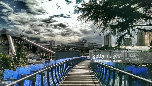 elevated walkway leading towards cityscape - coventry stock pictures, royalty-free photos & images