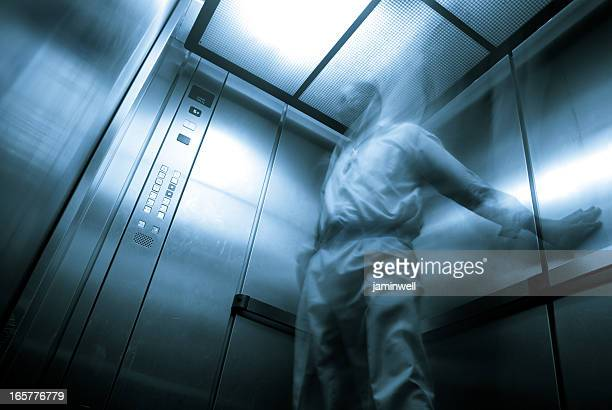 elevator claustrophobia; ghostly apparition in enclosed space - claustrophobia stock photos and pictures