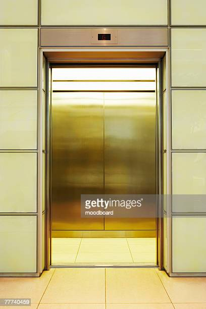 elevator - picking up stock pictures, royalty-free photos & images