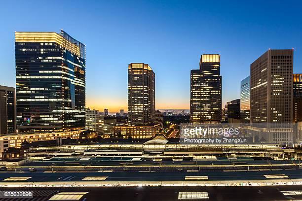Elevator Skyline of Marunouchi, Otemachi, back of Tokyo Station at twilight, Tokyo, Japan.